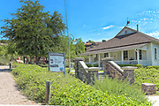 Main House with Informational Sign about Olinda Oil Museum and Trail