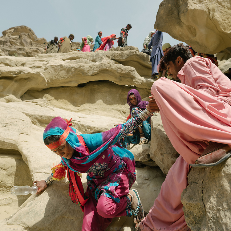 In extreme heat, pilgrims, young and old,  circumnavigate the shrine on foot, over mountain paths, stopping at springs.