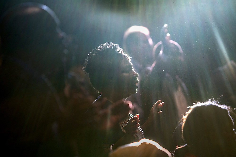 Marie Tolbert sings with the crowd at an Ebola Victims Memorial Service at Cross of Glory Lutheran Church in Brooklyn Center on Oct. 19, 2014.