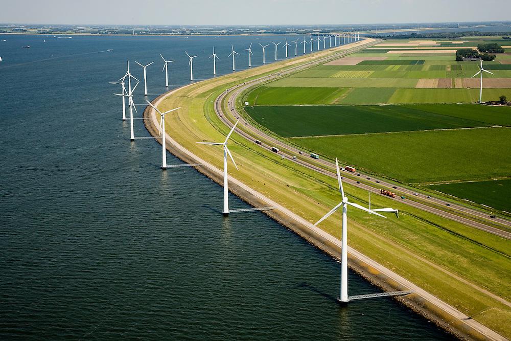 Nederland, Flevoland, IJsselmeerdijk, 14-07-2008; windmolens, onderdeel van het windmolenpark (of windpark) in het water van het IJsselmeer, omgeving van de Flevocentrale; in de achtergrond de A6; turbine, wiek windturbine, windmolen, groene energie.Windpark for green power / green nergy in the new IJsselmeer polder Flevoland . .luchtfoto (toeslag); aerial photo (additional fee required); .foto Siebe Swart / photo Siebe Swart