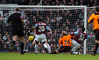 Derek Geary shoots goalwards for the Sheffield United goal, which was credited as a Tomas Repka own goal. Credit: Back Page Images / Matthew Impey. West Ham United v Sheffield United, The Coca Cola Championship, 3/01/2004.