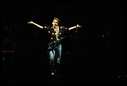 Bob Weir, arms outstretched. The Grateful Dead perfoming Picasso Moon at the Nassau Coliseum, Uniondale NY, 30 March 1990