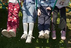 Group of children sitting on swing,