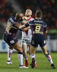 St Helens' Luke Thompson is tackled by Leeds Rhinos Jamie Jones-Buchanan (left) and Matt Parcell (right) during the Betfred Super League match at The Totally Wicked Stadium, St Helens.