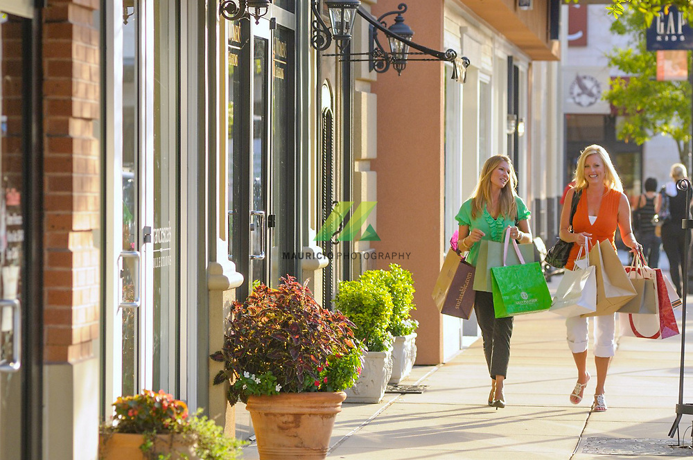 Womans shopping. Happy woman with shopping bags enjoying in shopping. Consumerism, shopping, lifestyle concept