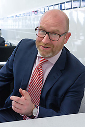 © Licensed to London News Pictures. 20/05/2017. LONDON, UK.  PAUL NUTTALL, UKIP leader takes a break in a pie and mash shop in Elm Park after campaigning with UKIP candidate for Dagenham and Rainham, Peter Harris. All political parties continue to campaign across the UK ahead of the general election taking place on 8th June. Photo credit: Vickie Flores/LNP