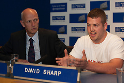 © licensed to London News Pictures. London, UK 06/08/2012. Missing 12-year-old Tia Sharp's uncle David Sharp (right) talking at the press conference in New Scotland Yard. Tia is being searched around Croydon area and she has been missing for nearly 3 days. Photo credit: Tolga Akmen/LNP