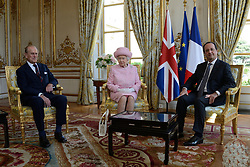 Buckingham Palace has announced Prince Philip, The Duke of Edinburgh, has passed away age 99 - FILE - HM The Queen Elizabeth II and HRH The Duke of Edinburgh are received by President François Hollande at the Elysee Palace, as part of the official ceremonies celebrating the 70th Anniversary of the D-Day. Paris, France on June 5, 2014. Photo by Nicolas Briquet/ABACAPRESS.COM