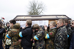 © Licensed to London News Pictures. 24/02/2014. Ukraine, The funeral in Kalush, western Ukraine, of Igor Dmytriv, an activist killed by a snipers bullet in Kyiv. Photo credit : Christopher Nunn/LNP