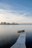 A rowing boat on a lake in the Cotswold Water Park
