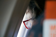 adult woman looking out the window of an airplane