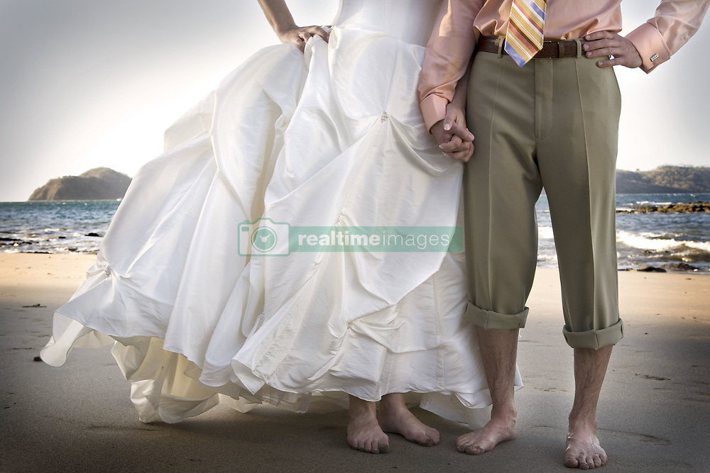 July 21, 2019 - Bride And Groom Holding Hands On Beach (Credit Image: © Caley Tse/Design Pics via ZUMA Wire)