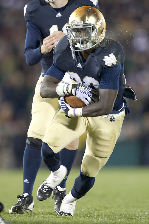 Notre Dame running back Cierre Wood (#20) bursts through the running lane during fourth quarter of NCAA football game between Notre Dame and Boston College.  The Notre Dame Fighting Irish defeated the Boston College Eagles 16-14 in game at Notre Dame Stadium in South Bend, Indiana.