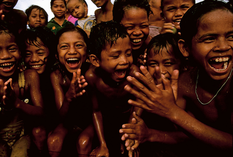 Cambodian children play in a newly dug clean water well.