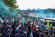 """Leicester, United Kingdom, May 24, 2021: Police not displaying their ID badges as observed by a field Logeal Observer are preparing to storm local men, women and children who gathered outside an Israeli owned weapons factory known as Elbit UAV, to support the """"Palestine Action"""" activists who had occupied the building for six consecutive days. Multiple members of the public were arrested by the police after they tried to provide food and water to activists standing on the rooftop of the building on the same day. (Photo by Vudi Xhymshiti)"""