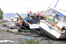 July 21, 2017 - Mugla, Turkey - Damaged boats are seen on a beach following a sea surge caused by an earthquake, in the Agean coastal city of Mugla, Bodrum. A strong 6.7 magnitude earthquake hit Turkey's Aegean coast, and at least 90 people were injured as a sea surge caused damages in buildings and streets. Two people were killed and dozens were injured on the Greek Island of Kos and beachfront hotels have been flooded on both Turkish and Greek coasts after the earthquake hit in the Aegean Sea. (Credit Image: © Dha/Depo Photos via ZUMA Wire)
