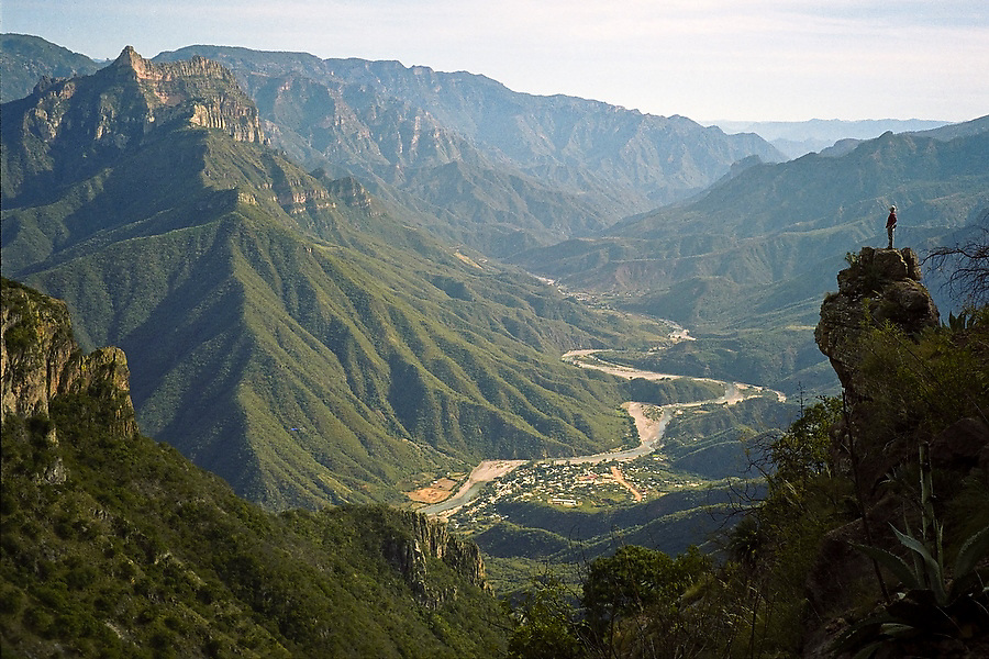 Hiker Ethan Welty looks down over the Copper Canyon (Barrancas del Cobre) and the village of Urique, Chihuahua, Mexico.