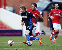 Fotball<br /> England<br /> Foto: Colorsport/Digitalsport<br /> NORWAY ONLY<br /> <br /> Football<br /> Npower Championship<br /> Barnsley vs Portsmouth<br /> at Oakwell Stadium<br /> Barnsley's Jim O'Brien battles with Portsmouth's Erik Huseklepp<br /> 18/02/2012