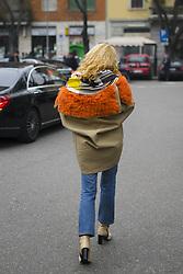 January 15, 2018 - Milan, Italy - Elina Halimi wearing white knit, cropped denim jeans, ankle boots, beige orange jacket, bag is seen outside No21 during Milan Men's Fashion Week Fall/Winter 2018/19 on January 15, 2018 in Milan, Italy. (Credit Image: © Nataliya Petrova/NurPhoto via ZUMA Press)
