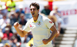 Australia's Pat Cummins celebrates the wicket of Joe Root during day one of the Ashes Test match at the WACA Ground, Perth.
