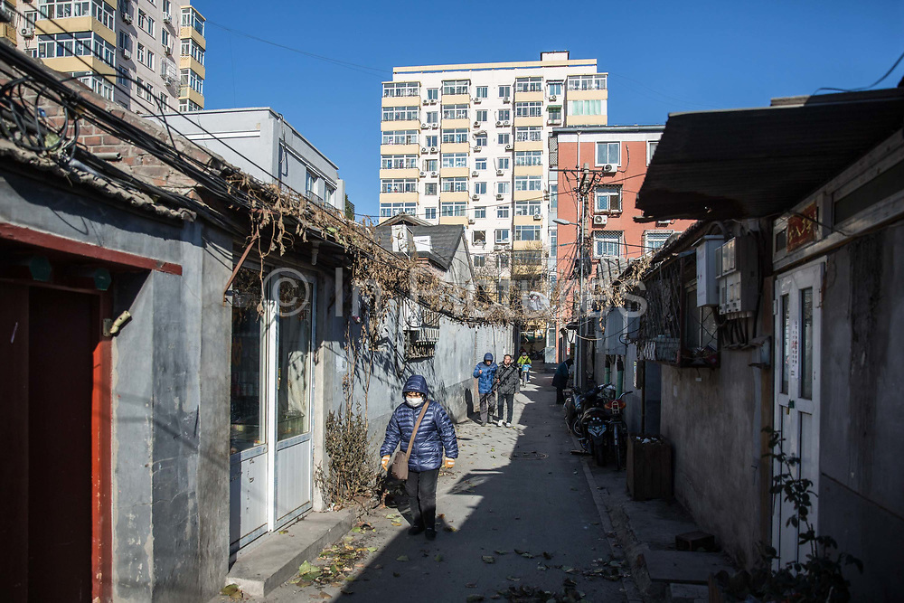 Residents all through a traditional Hutong in Beijing, China, on Tuesday, Dec. 01, 2015.