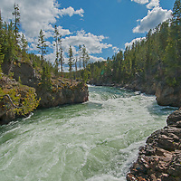 The Yellowstone River approaches Upper Yellowstone Falls in Yellowstone National Park.