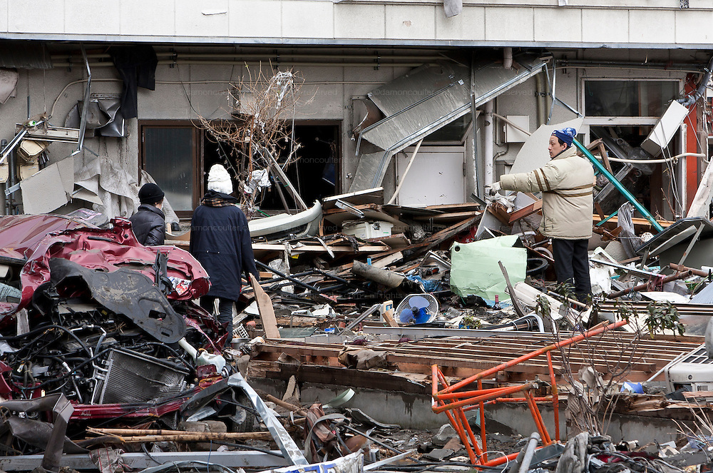 People salvage belongings from wrecked houses after the tsunami that struck north east Japan on March 11th Kamaishi,, Iwate, Japan. March 17th 2011