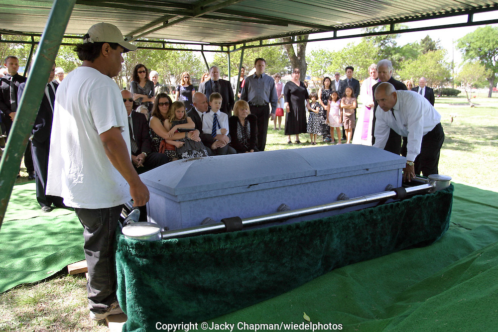 Family burying family member in Texas USA