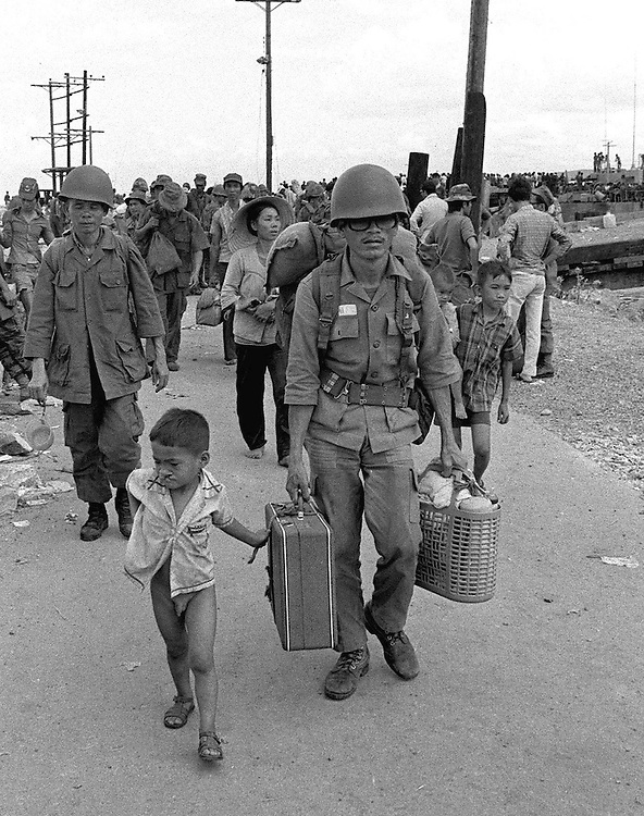 South Vietnamese refugees and soldiers seen in Vung Tau, Vietnam. April 1975. Photographed by Terry Fincher