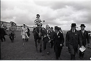 """26/06/1965<br /> 06/26/1965<br /> 26 June 1965<br /> Irish Sweeps Derby at the Curragh Race Course, Co. Kildare. Image shows """"Meadow Court"""" (L. Piggott up) jointly owned by Bing Crosby, Mrs Frank McMahon and Mr. G.M. Bell after winning the Irish Derby at the Curragh. Bing Crosby 2nd from left.  Mr. """"Max"""" Bell leading the horse."""