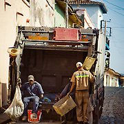 A garbage truck on its route through the historical town of Trinidad, Cuba.
