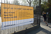 As the UK government's lockdown restrictions during the Coronavirus pandemic continues, and number of UK reported cases rose to 138,078 with a total now of 18,738 deaths, a runner passes a banner by Lambeth Council advising on social distancing restrictions and overall behaviour has been stretched across the gates of Brockwell Park, a public green space in the south London borough of Lambeth, on 23rd April 2020, in London, England.