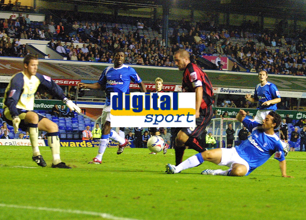 Photo: Dave Linney.<br />Birmingham City v Shrewsbury Town. Carling Cup. 22/08/2006.Shrewbury's Richard Hope (C) is sent crasing to the ground by  Stephen Kelly