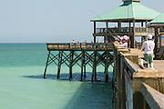 People fish from Folly Beach Pier May 12, 2014 in Folly Beach, Charleston, SC.