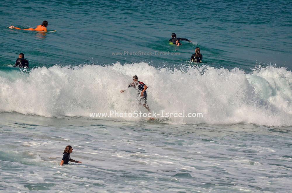 Wave Surfing in the Mediterranean Sea. Netanya, Israel