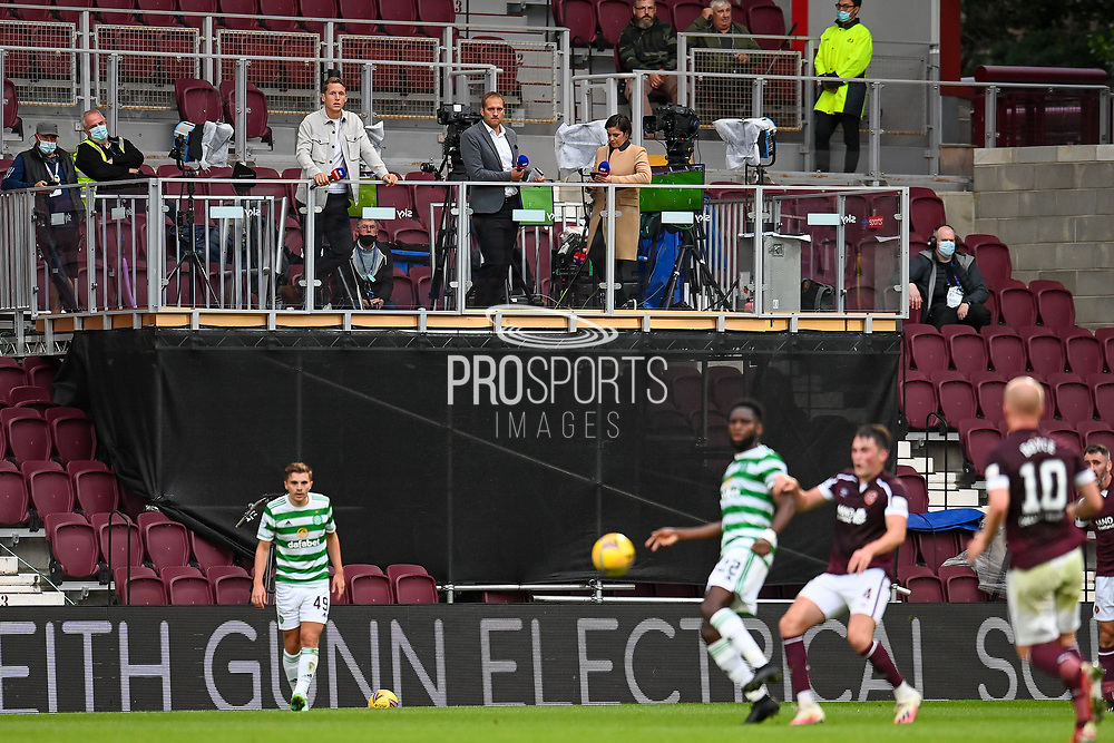 Sky Sports pundits Christophe Berra and Stiliyan Petrov watch from the TV gantry during the Cinch SPFL Premiership match between Heart of Midlothian FC and Celtic FC at Tynecastle Park, Edinburgh, Scotland on 31 July 2021.