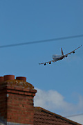 A Malaysian airways Boeing 747 soaring over local houses in Hatton near London Heathrow airport.