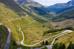 Aerial view of Glen Croe showing new and old military road from Rest and Be Thankful pass in Argyll and Bute, Scotland, Uk
