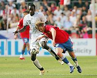 Photo: Chris Ratcliffe.<br /> Czech Republic v Ghana. Group E, FIFA World Cup 2006. 17/06/2006.<br /> Otto Addo of Ghana clashes with Jaroslav Plasil of the Czech Republic.