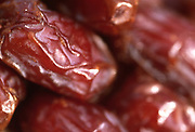 Close up selective focus photo of a bunch of Dates