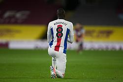 Cheikhou Kouyate of Crystal Palace takes a knee before the match - Mandatory by-line: Jack Phillips/JMP - 23/11/2020 - FOOTBALL - Turf Moor - Burnley, England - Burnley v Crystal Palace - English Premier League