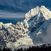 Mt. Thamserku rises above a forest in the Khumbu region of Nepal 1986.