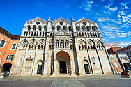 Facade of the 12th century Romanesque Ferrara Duomo, Italy .Ferrara Cathedral (Basilica Cattedrale di San Giorgio, Duomo di Ferrara) is a Roman Catholic cathedral and minor basilica in Ferrara, Northern Italy. The original Romanesque design of Ferrara Cathedral is manifest in the façade. In the centre of the façade of Ferrara Cathedral is a porch, supported by two columns with Atlases seated on lions at the bases. It is decorated with a Last Judgement by an unknown master and a loggia with a Madonna and Child (a late Gothic addition). The portal of Ferrara Cathedral is the work of the sculptor Nicholaus, a pupil of Wiligelmus. The lunette shows Saint George, patron saint of Ferrara, slaying the dragon; scenes from the Life of Christ appear on the lintel. The jambs framing the entrance of Ferrara Cathedral are embellished with figures depicting the Annunciation and the four prophets who foretold the coming of Christ.<br /> <br /> Visit our ITALY PHOTO COLLECTION for more   photos of Italy to download or buy as prints https://funkystock.photoshelter.com/gallery-collection/2b-Pictures-Images-of-Italy-Photos-of-Italian-Historic-Landmark-Sites/C0000qxA2zGFjd_k<br /> <br /> If you prefer to buy from our ALAMY PHOTO LIBRARY  Collection visit : https://www.alamy.com/portfolio/paul-williams-funkystock/ferrara.html .