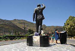 Visitors place flowers at the statue of Nelson Mandela at the entrance of the Groot Drakenstein Prison formerly known as the Victor Verster Prison in Paarl, just outside of Cape Town. The statue is at the place Nelson Mandela walked out of prison, a free man, on 11 February 1990, PAARL, SOUTH AFRICA, Sunday, 8th December 2013. Picture by Roger Sedres / i-Images