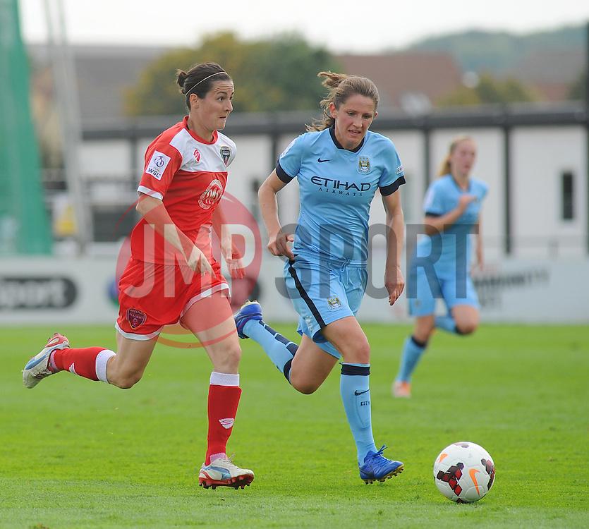 Bristol Academy Womens' Natalia Pablos Sanchon battles for ball possession. - Photo mandatory by-line: Nizaam Jones- Mobile: 07583 387221 - 28/09/2014 - SPORT - Women's Football - Bristol - SGS Wise Campus - BAWFC v Man City Ladies - sport