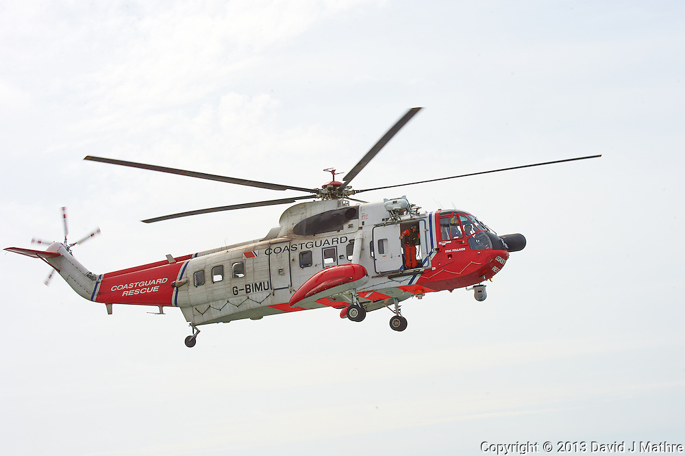 Netherlands Coast Guard Rescue Helicopter (G-BIMU, Stac Pollaidh) Hovering Near the Semester at Sea M/V Explorer in the North Sea. Image taken with a Nikon D4 and 80-400 mm VRII lens (ISO 800, 400 mm, f/14, 1/800 sec).