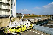 Nederland, Zeeland, Gemeente Noord-Beveland, 16-03-2016; Kats, Zandkreekdam. Sluis in de dam met meetschip RR. Roompot van Rijkswaterstaat.<br /> <br /> copyright foto/photo Siebe Swart