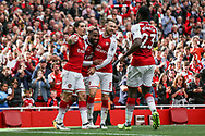 Alexandre Lacazette (2nd left) of Arsenal celebrates with his teammates after he scores his teams second goal of the game.  Premier league match, Arsenal v AFC Bournemouth at the Emirates Stadium in London on Saturday 9th September 2017. pic by Kieran Clarke, Andrew Orchard sports photography.