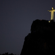 The iconic Cristo Redentor, Christ the Redeemer statue   lit up at night time atop the mountain Corcovado. The Christ statue was voted one of the seven wonders of the modern world in 2007. It was designed by Brazilian Heitor de Silva Costa and was inaugurated in 1931 having taken years to assemble. Rio de Janeiro, Brazil. 22nd July 2010. Photo Tim Clayton..