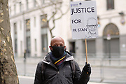 "People from ""Jesuit Mission"" hold placards outside Indian High Comission in London to protest against arrest of Father Stan Swamy on Thursday, Dec 10, 2020. <br /> The National Investigation Agency (NIA), which deals with anti-terror crimes, arrested him in connection over a 2018 incident of caste-based violence and alleged links with Maoists. The 83-year-old activist and Jesuit priest is now the oldest person to be accused of terrorism in India. (VXP Photo/ Gio Strondl)"